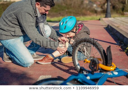 Man helping a boy with a injury Stock photo © bluering