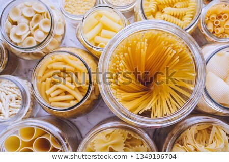 Сток-фото: Container With Macaroni Of Different Shape