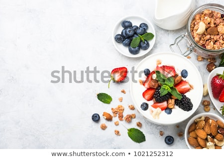 homemade natural breakfast with granola strawberries almonds blueberries raspberry fresh soy mi stock photo © artjazz
