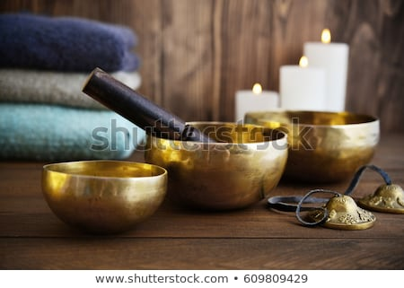 Sound massage with singing bowls and cymbals Stock photo © Kzenon