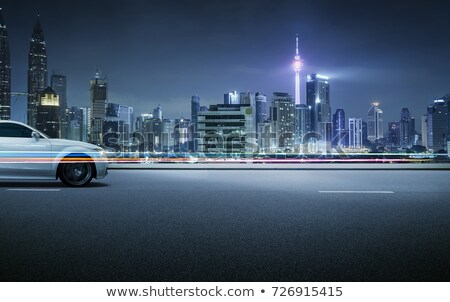 Roadside View with Modern City and Golden Sky Stock photo © colematt
