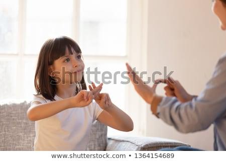 Nina aprendizaje signo idiomas mujer niña feliz Foto stock © AndreyPopov
