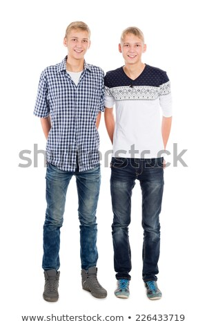 Full length portrait of a two young cheerful twin brothers Stock photo © deandrobot