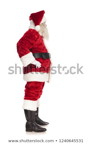 santa claus waiting in line while holding hips stock photo © feedough