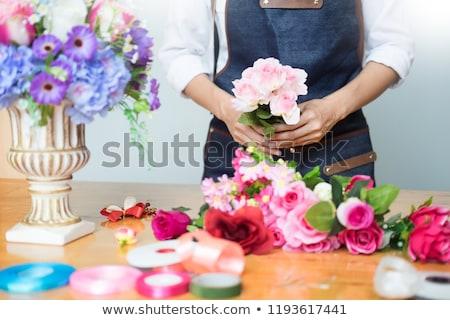 Female Florist at work using Arranging making beautiful Artifici Stock photo © snowing
