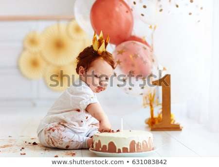 egyéves · fiú · ünnepel · első · születésnap · eszik - stock fotó © Stasia04