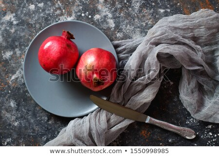 Fresh whole pomegranate on a vintage plate Stock photo © madeleine_steinbach
