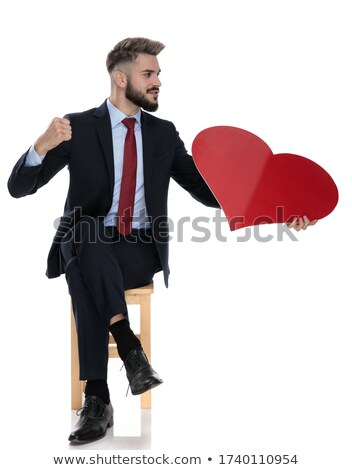 сидящий моде человека большой красный сердце Сток-фото © feedough