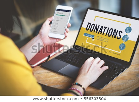 Charity, donation and fundraising concept - volunteer helping ha Stock photo © Winner