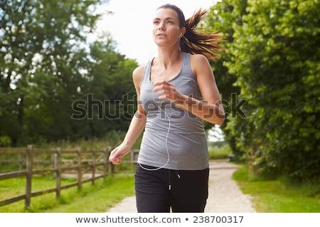 Kobieta uruchomiony zewnątrz sportu ubrania Zdjęcia stock © boggy