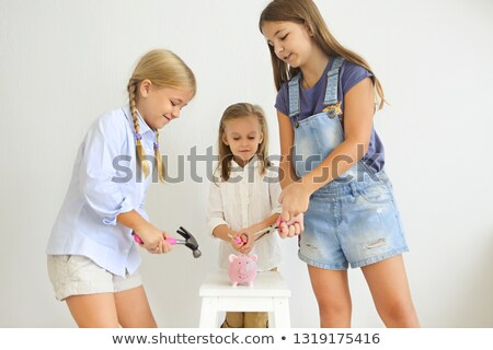 Kids with screwdriver, pliers and hammer by the pink pig piggy b Stock photo © dashapetrenko