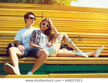 молодым · человеком · мобильных · домой · женщину · сидят · диван - Сток-фото © deandrobot