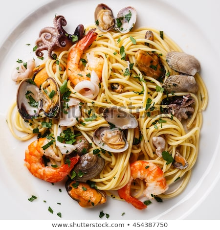Spaghetti seafood pasta with clams and prawns Stock photo © karandaev