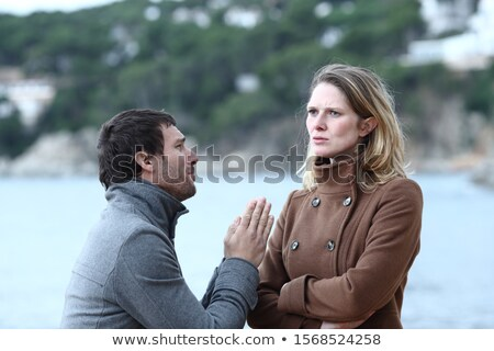 Husband Requesting His Sad Wife Stock photo © AndreyPopov