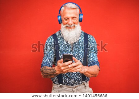 Pensioner Listening to Music Device, Senior People Stock photo © robuart
