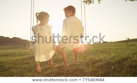 young boy in the meadow at the sunset holding heart stock photo © lopolo
