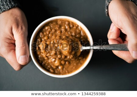 man eating a lentil soup stock photo © nito