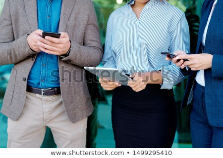 Midsection of three employees or millennials with touchpad and smartphones Stock photo © pressmaster