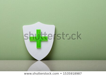 Close-up Of A Shield With Plus Sign  Stock photo © AndreyPopov