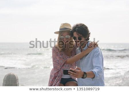Genç kafkas çift cep telefonu Stok fotoğraf © wavebreak_media