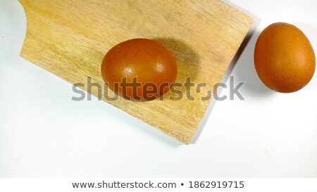 Two brown eggs on cutting board Stock photo © Digifoodstock