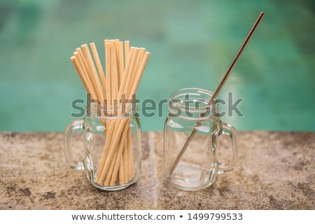 Steel drinking vs disposable straws on pool background. Zero waste concept Stock photo © galitskaya