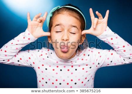 Stock photo: Children pulling faces