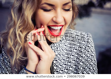 close up red lips and teeth stock photo © rtimages