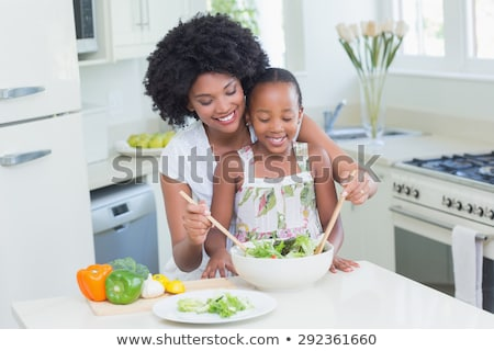 Young girl tossing a salad Stock photo © photography33