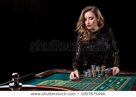tenso · olhando · mulher · jogar · pôquer · branco - foto stock © rob_stark