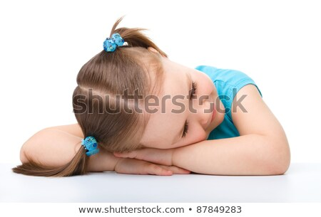 Brunette laying with her head in her hands Stock photo © photography33