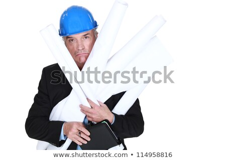 Pouting engineer carrying a stack of rolled-up drawings Stock photo © photography33