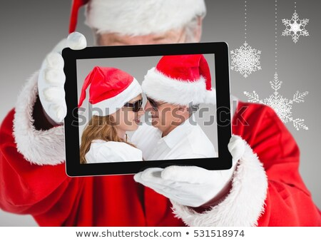 woman in a santa claus suit wearing sunglasses stock photo © photography33