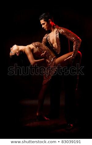 Gyönyörű salsa táncos fekete ruha oldalnézet néz Stock fotó © feedough