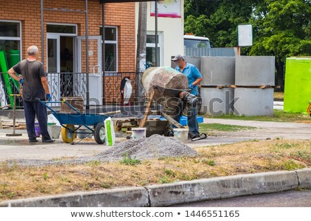 Builder using a cement mixer Stock photo © photography33
