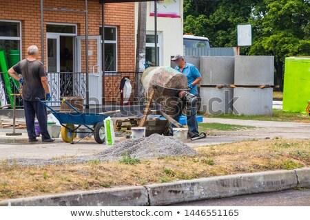 Stock fotó: Builder Using A Cement Mixer