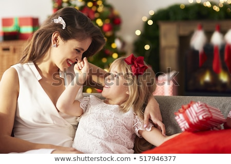 teasing woman with a christmas gift stock photo © stryjek