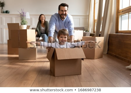 three young people in a room full of cardboard boxes stock photo © photography33