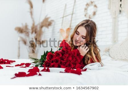 atraente · jovem · pétalas · de · rosa · retrato · mulher - foto stock © acidgrey