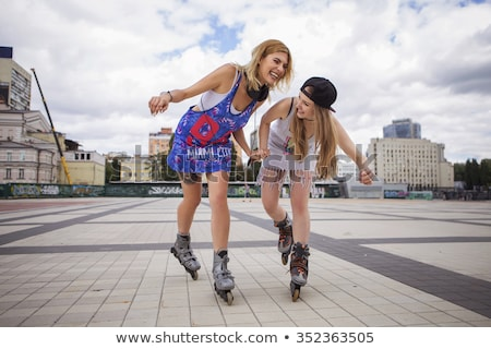 attractive young blonde on roller skates stock photo © acidgrey