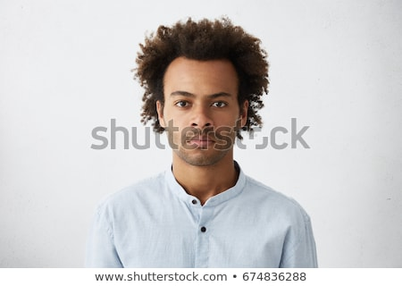 Young male in thoughts against a white background stock photo © wavebreak_media