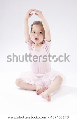 Smiling ballerina against a white background Stock photo © wavebreak_media