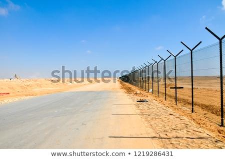 Sivatag kerítés terméketlen drámai égbolt fa Stock fotó © jkraft5