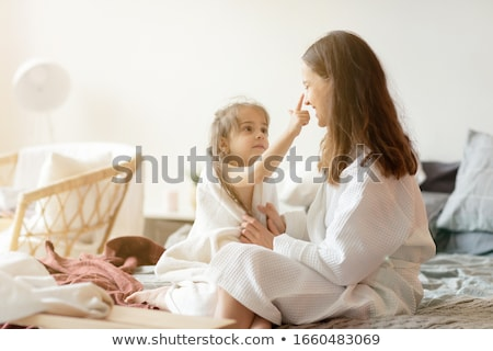 Portrait of adorable young girl and mother in a playful mood hav Stock photo © HASLOO