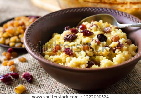 Millet porridge with berry Stock photo © fanfo