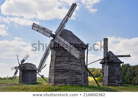 three old wooden windmills stock photo © borysshevchuk
