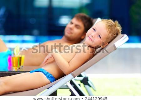 portrait of cute boy at the beach stock photo © meinzahn