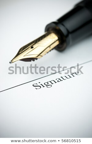gold pen with signature line of document stock photo © ambientideas