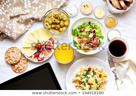 Fresh continental breakfast. Healthy food. Tablet, black screen. Stock photo © dariazu