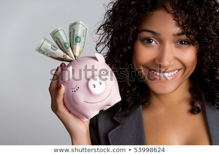 businesswoman holding piggy bank dollar bills stock photo © ichiosea